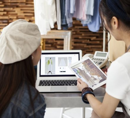 Two women selling clothes at online shopping